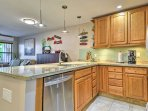 The fully equipped kitchen features new stainless steel appliances.