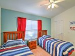 The kid's room features 2 twin beds and adorable Mickey Mouse decor.