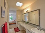 The master bathroom has dual sinks and a large vanity mirror.