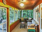 This screened-in porch is equipped with patio furniture and a futon for additional sleeping accommodations.
