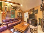 Sit back and relax on one of the comfortable couches next to the wood-burning fireplace and turn on the TV to find a...
