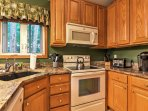 In the kitchen, you'll also find a Keurig coffee maker with provided coffee and creamer.