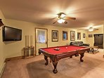 Downstairs, you'll find  a custom-built bar, pool table, stereo, TV and beverage fridge.