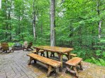 The patio offers a picnic table and fire pit.