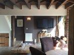 part oak beams. Flat screen TV and flagstone floor