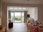 Open plan dining (seating for 6 & highchair available), living with enviable countryside views