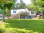 Two levels of living space. Large home on a spacious lot. Gentle slope to dock & lake- no stairs!