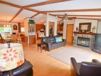 Upstairs open Great Room area. Plenty of dining space, stocked kitchen, and fireplace