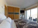 Air-conditioned bedroom with double bed, satellite TV and balcony