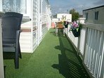 Artificial grass on the gated veranda.