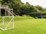 The communal play area with trampoline, football goals and table tennis table