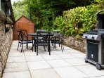 The private terrace with BBQ and fire pit table