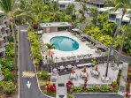 The view from above.  The pool and outdoor dining area.  My condo is upper left, behind the palms.