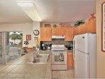 Full size refrigerator, stove and dishwasher.