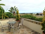 back patio overlooking the golf course with view of the ocean