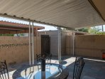 Private Patio and outside dining area - seats 4. Back door gate leads to private 2-car parking.