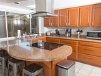 Kitchen - fully furnished with stainless steel appliances.