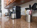 Kitchen is fully equipped with a toaster, knife set, coffee maker and kitchen utensils.