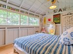 'Sean's Surf Shack' provides additional sleeping accommodations, with warm natural light and fun decorations.