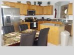 Updated kitchen with stainless steel appliances and granite counter tops.