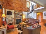 Elevate your Great Smoky Mountains getaway with this 3-bedroom, 2-bathroom Pigeon Forge vacation rental cabin!