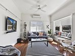 Comfortable lounge room with Smart TV, sunny window seat