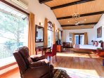 The master bedroom wooden floors large glazed windows with lofty ceilings and a lazy boy recliner