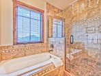 Master Bath with Dual Sinks, a Soaking Tub and Separate Tile Shower