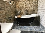 The en suite/upstairs bathroom, with a rolltop bath and sky window to watch the stars while you soak