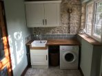 The utility room, leading the the rear courtyard.