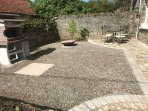 The front South facing courtyard - a real sun trap. Large BBQ and fire pit for your use too.