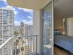 Step out onto the private deck overlooking the city.