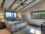 Another view of the master bedroom with a king bed