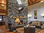Revel in deep conversation with your loved ones next to the floor-to-ceiling stone fireplace.