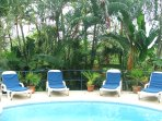 The private sun-terrace is set in a lush tropical garden.