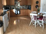 Kitchen with washing machine, tumble dryer, dishwasher and microwave - plus usual small appliances.