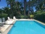 Backyard of Villa Watson w/ private pool overlooking golf course.