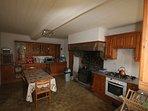 Large farmhouse kitchen with fitted dishwasher, fridge and freezer.