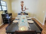 The dining room table comfortably fits 8 people for your dine-in vacation meals.