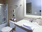 The bathtub and adjustable showerhead in the guest bathroom are perfect for bathing kiddos after a long day at the...