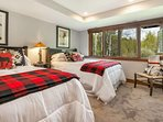 Bedroom 3, located on the lowest level, is furnished with 2 full size beds, mounted flat screen TV and east facing...