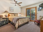 Bedroom 2 with queen bed and 32' flat screen TV is located on the entry level and shares a bath with bedroom 3.