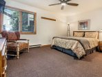 Bedroom 3 with queen bed and 32' flat screen TV is located on the entry level and shares a bath with bedroom 2.