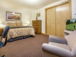 Bedroom 4 with queen bed and 32' flat screen TV is located on the sub level and shares a bath with bedroom 5 and the...