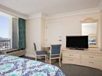 Flat screen television with satellite TV and free HBO and sitting area for 2.