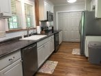 Our well-appointed kitchen features new appliances, subway tile backsplash, & under-cabinet lights.