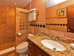 2 full bathrooms with granite &  travertine. Island water is precious so bathtubs are rare.