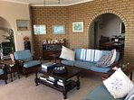 Carpeted lounge with arch to the diningroom