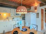 Dining room and kitchen. Electric stove with 4 burners