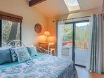 Guest room with trundle bed and private patio access.